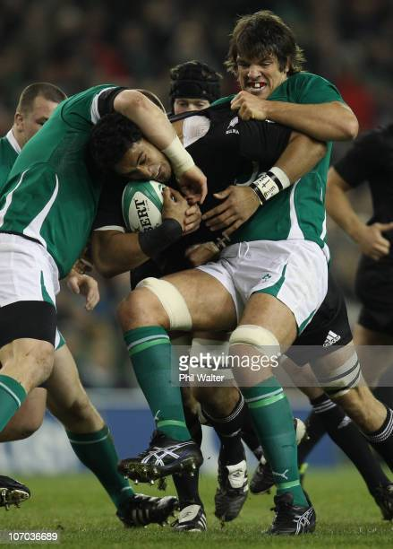 Jerome Kaino of the All Blacks is tackled by Donncha O'Callaghan of Ireland during the Test match between Ireland and the New Zealand All Blacks at...