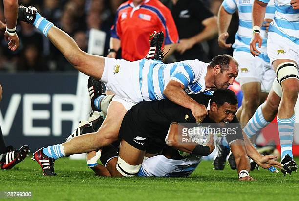 Jerome Kaino of the All Blacks is tackled by Mario Ledesma Arocena of Argentina during quarter final four of the 2011 IRB Rugby World Cup between New...
