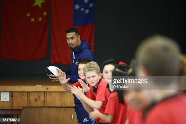 Jerome Kaino of the Auckland Blues passes a ball during the New Zealand Lions Series Education Programme Launch at Remuera Intermediate School on May...