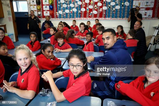 Jerome Kaino of the Auckland Blues sits in class during the New Zealand Lions Series Education Programme Launch at Remuera Intermediate School on May...