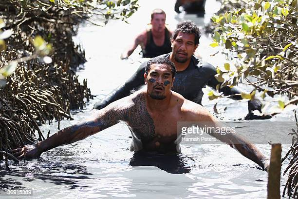 Jerome Kaino of the Auckland Blues Super Rugby team takes part in the Annual Naval Base Mud Run at the Devenport Naval Base on January 13 2012 in...