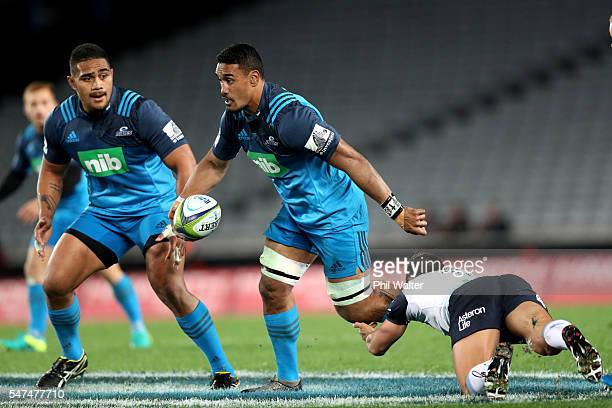 Jerome Kaino of the Blues is tackled by Nick Phipps of the Waratahs during the round 17 Super Rugby match between the Blues and the Waratahs at Eden...
