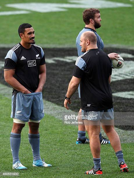 Jerome Kaino talks to Ben Franks during the New Zealand All Blacks captain's run at Forsyth Barr Stadium on June 13 2014 in Dunedin New Zealand