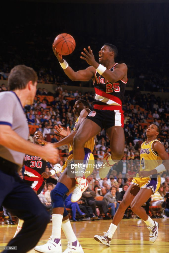 Jerome Kersey of the Portland Trail Blazers shoots against the Los Angeles Lakers during the 19871988 NBA season game at the Great Western Forum in...