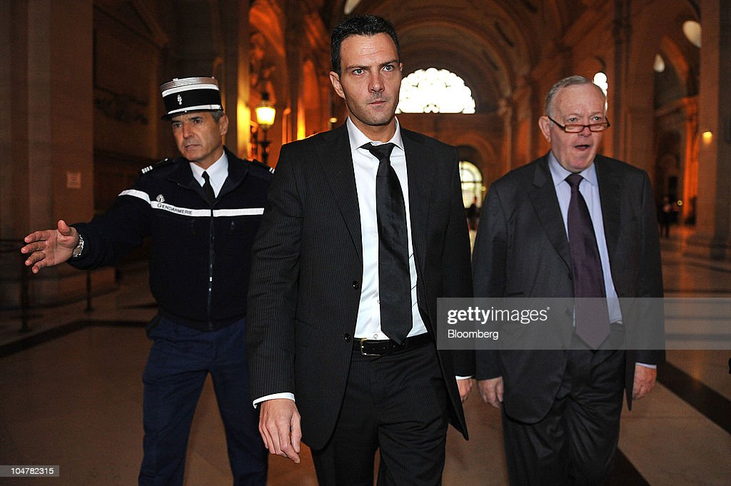 Jerome Kerviel former Societe Generale SA trader center and his lawyer Olivier Metzner right arrive at a courthouse in Paris France on Tuesday Oct 5...