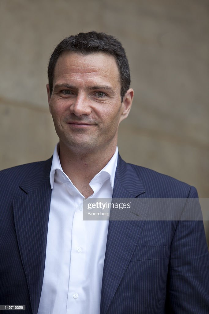 Jerome Kerviel the former trader at Societe Generale SA pooses for a photograph outside the Paris appeal courts during a break on the opening day of...