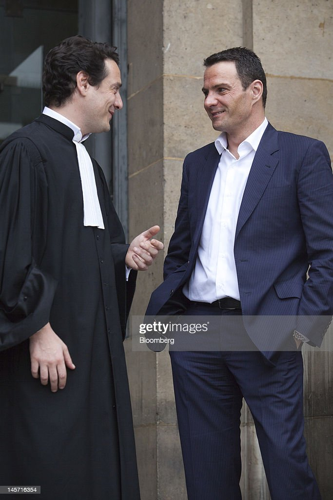 Jerome Kerviel the former trader at Societe Generale SA right speaks with his lead lawyer David Koubbi outside the Paris appeals court during a break...