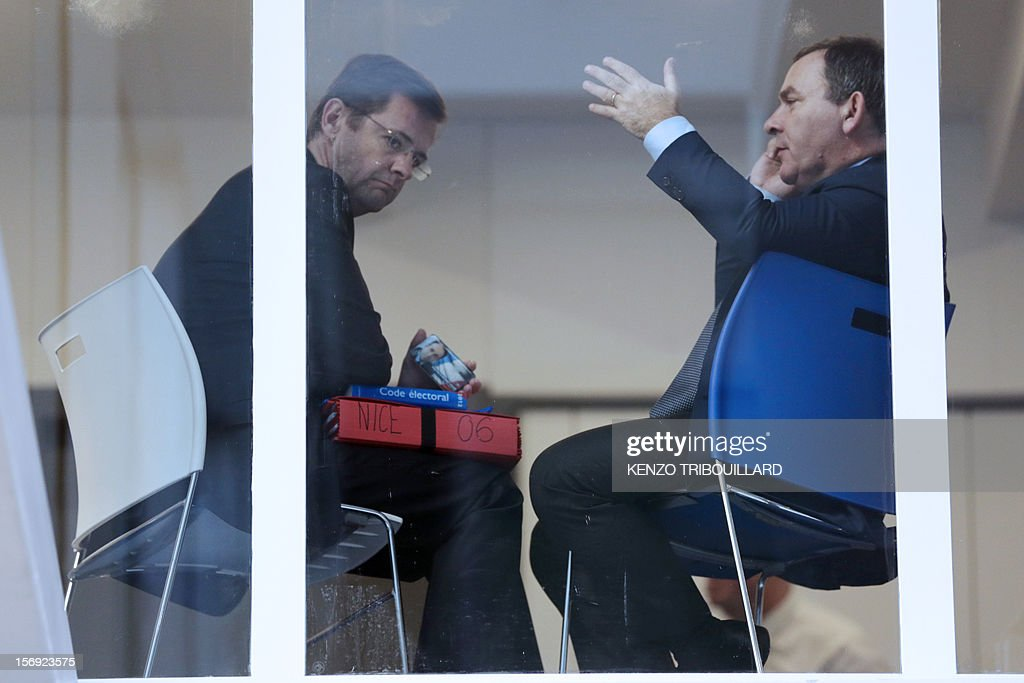Jerome Lavrilleux (L), cabinet director of newly-elected president of the right-wing UMP opposition party, Jean-Francois Cope at the UMP's elections control committee (COCOE) sits beside French lawyer and pro-Cope supporter, Francis Szpiner (R) at the UMP party's headquarters in Paris on November 25, 2012. Szpiner declared a 'desertion' the fact that French former Prime minister Francois Fillon's campaign director, Eric Ciotti slammed the door from the UMP's appeal elections control board, after considering it illegitimate and biased. Party heavyweight Juppe, a former premier and foreign minister, will hold a mediation meeting later in the day with the right-winger, who was declared the winner of November 22 knife-edge vote to pick a party leader, Jean-Francois Cope, and his centrist rival Francois Fillon. The talks are to establish who actually won the leadership and whether mutual allegations of ballot rigging have any foundation. AFP PHOTO KENZO TRIBOUILLARD
