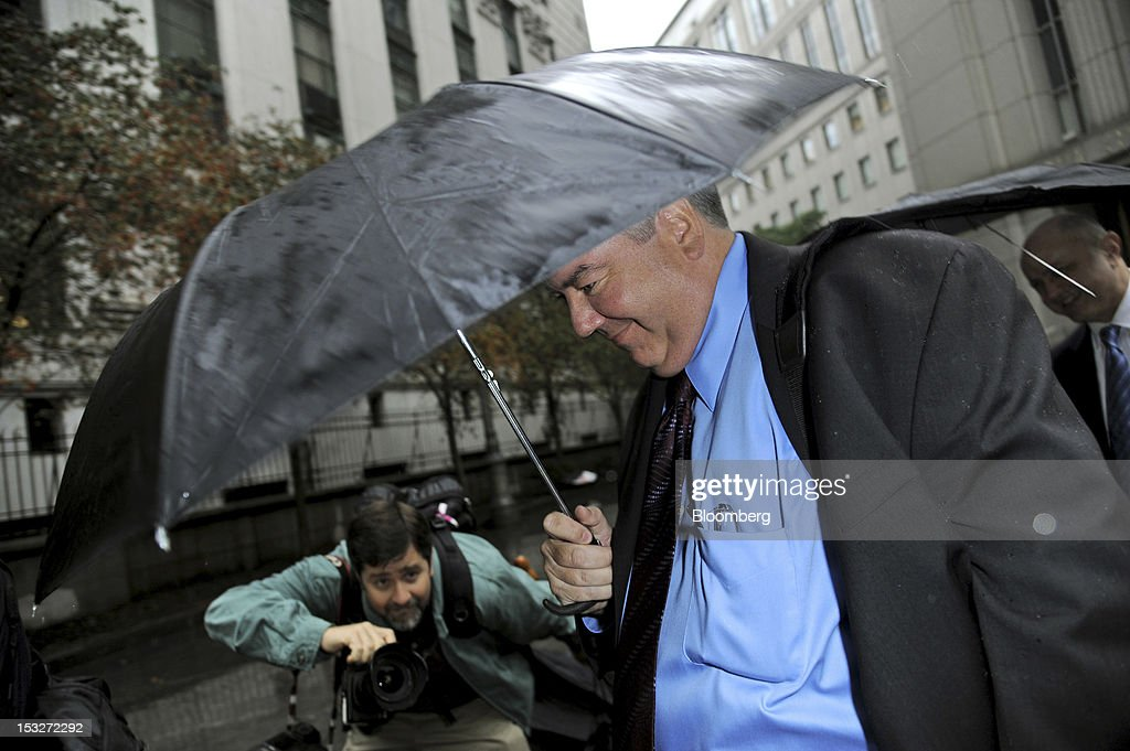 Jerome O'Hara, a former employee at Bernard L. Madoff Investment Securities LLC, exits federal court in New York, U.S., on Tuesday, Oct. 2, 2012. Five longtime employees of Bernard Madoff's former investment firm face more charges related to the jailed con man's Ponzi scheme, which the government claims got its start in the 1970s. Photographer: Peter Foley/Bloomberg via Getty Images