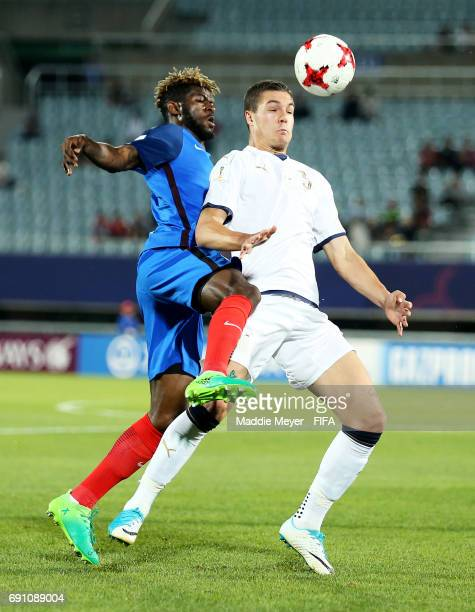 Jerome Onguene defends Federico Dimarco of Italy during the FIFA U20 World Cup Korea Republic 2017 Round of 16 match between France and Italy at...
