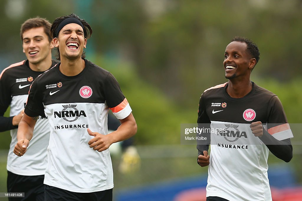Jerome Polenz and Youssouf Hersi share a laugh during a Western Sydney Wanderers A-League training session at Blacktown International Sportspark on February 12, 2013 in Sydney, Australia.