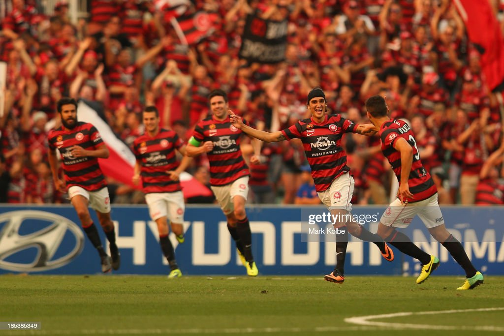 <a gi-track='captionPersonalityLinkClicked' href=/galleries/search?phrase=Jerome+Polenz&family=editorial&specificpeople=790750 ng-click='$event.stopPropagation()'>Jerome Polenz</a> of the Wanderers celebrates scoring a goal during the round two A-League match between the Western Sydney Wanderers and Wellington Phoenix at Parramatta Stadium on October 20, 2013 in Sydney, Australia.