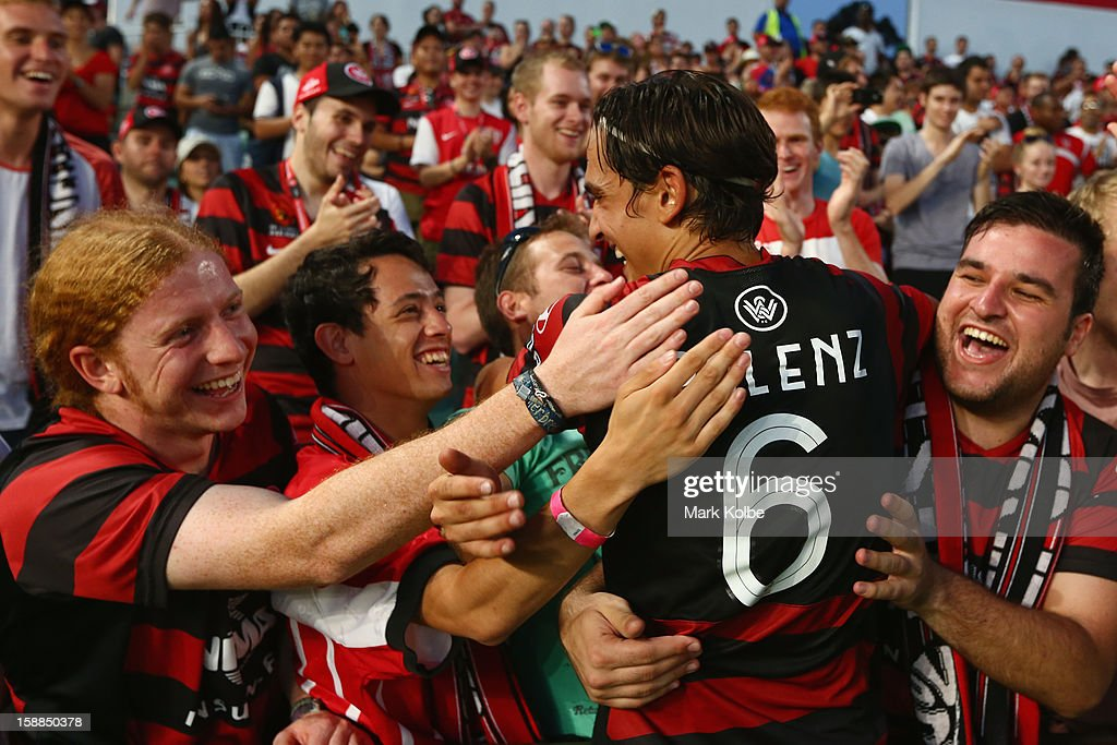 Jerome Polenz of the Wanderers celebrates with the crowd after victory in the round 14 A-League match between the Western Sydney Wanderers and the Melbourne Victory at Parramatta Stadium on January 1, 2013 in Sydney, Australia.