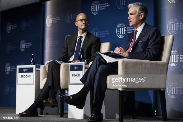 Jerome Powell governor of the US Federal Reserve right speaks as Robin Brooks managing director and chief economist of the IIF listens during the...