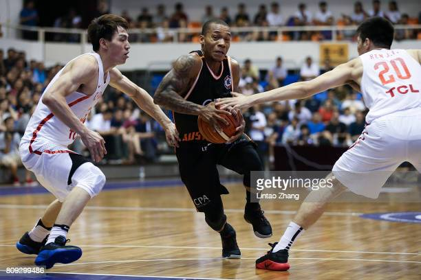 Jerome Randle of Australia looks to pass against Ren Junfei of China during the 2017 SinoAustralia Men's International Basketball Challenge at...