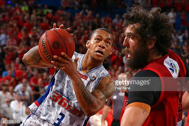 Jerome Randle of the 36ers charges into Matt Knight of the Wildcats during the round five NBL match between the Perth Wildcats and the Adelaide 36ers...