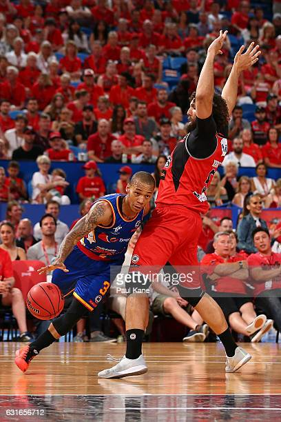 Jerome Randle of the 36ers drives to the basket against Matt Knight of the Wildcats during the round 15 NBL match between the Perth Wildcats and the...