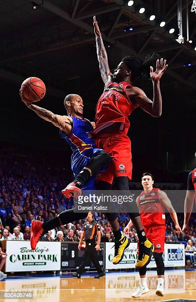 Jerome Randle of the Adelaide 36ers drives to the basket over Jameel McKay of the Perth Wildcats during the round 12 NBL match between the Adelaide...