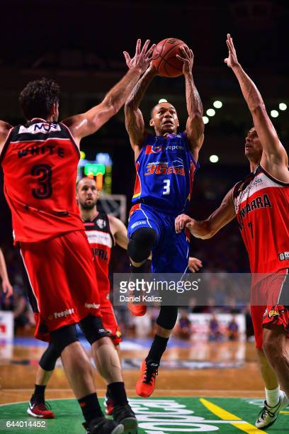 Jerome Randle of the Adelaide 36ers drives to the basket over Oscar Forman of the Illawarra Hawks during game three of the NBL Semi Final series...