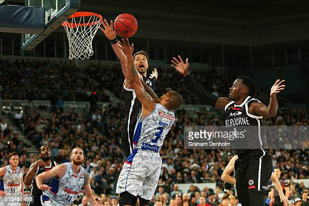 Jerome Randle of the Adelaide 36ers has a shot blocked by David Andersen of Melbourne United during the round one NBL match between Melbourne United...