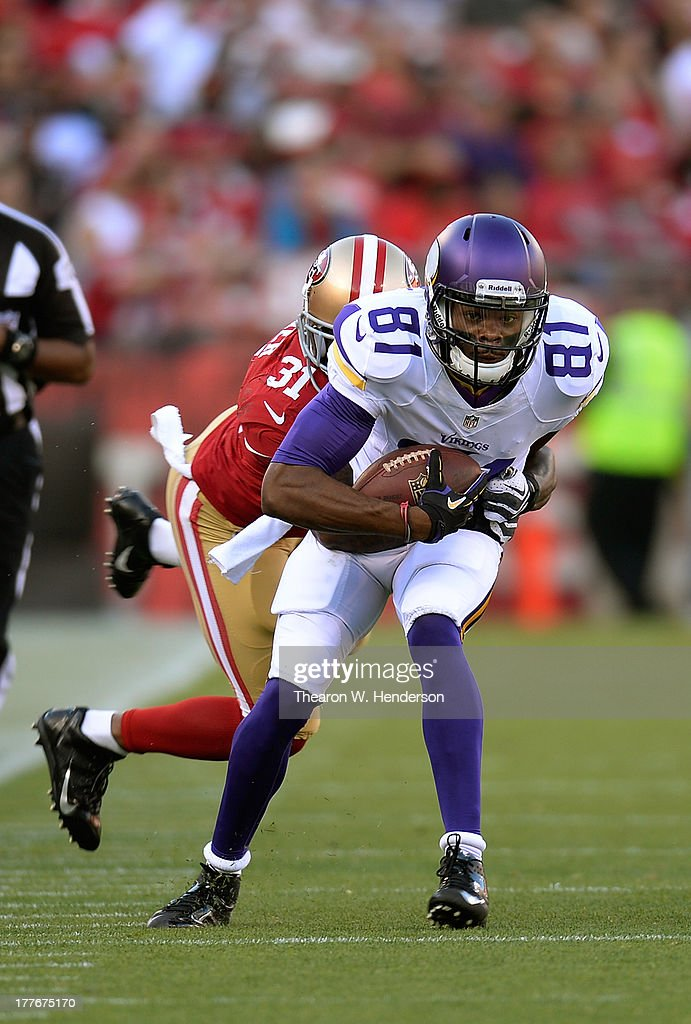 Jerome Simpson #81 of the Minnesota Vikings gets tackled by <a gi-track='captionPersonalityLinkClicked' href=/galleries/search?phrase=Donte+Whitner&family=editorial&specificpeople=649027 ng-click='$event.stopPropagation()'>Donte Whitner</a> #31 of the San Francisco 49ers after a seventeen yard pass play in the second quarter at Candlestick Park on August 25, 2013 in San Francisco, California.