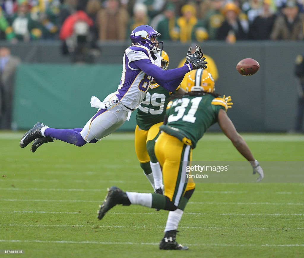 Jerome Simpson #81 of the Minnesota Vikings misses a catch during an NFL game against the Green Bay Packers at Lambeau Field on December 2, 2012 in Green Bay, Wisconsin.