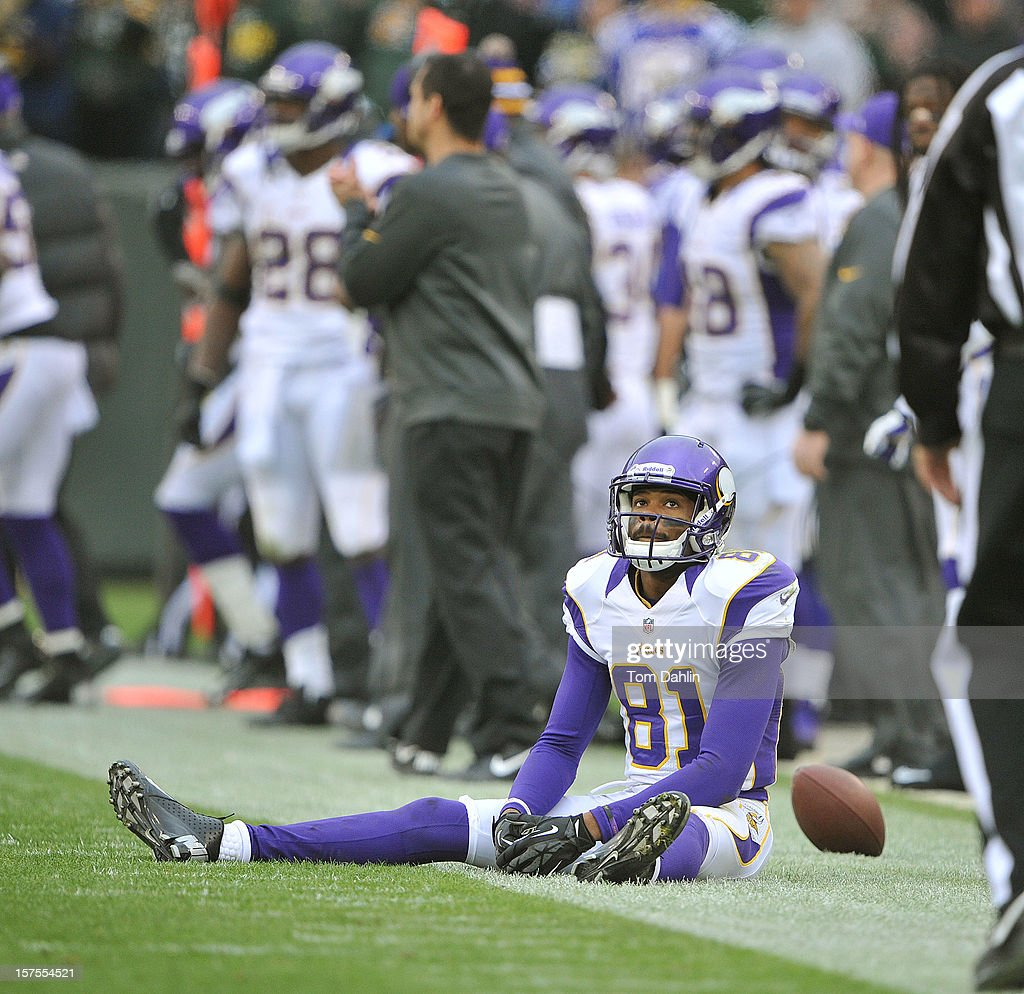 Jerome Simpson #81 of the Minnesota Vikings reacts after missing a catch during an NFL game against the Green Bay Packers at Lambeau Field on December 2, 2012 in Green Bay, Wisconsin.