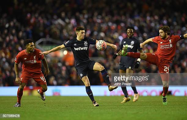 Jerome Sinclair of Liverpool and Joe Allen of Liverpool compete with Aaron Cresswell of West Ham United during The Emirates FA Cup Fourth Round...