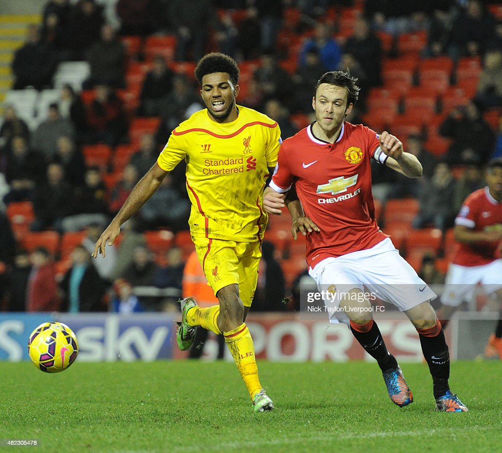 Jerome Sinclair of Liverpool and Tom Thorpe of Manchester United in action during the Barclays U21 Premier League match between Manchester United and Liverpool at Leigh Sports Village on January 26, 2015 in Leigh, Greater Manchester.