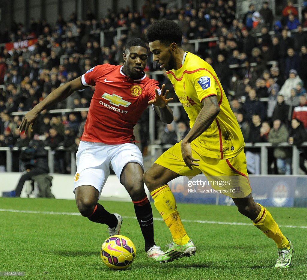 Jerome Sinclair of Liverpool and Tyler Blackett of Manchester United in action during the Barclays U21 Premier League match between Manchester United and Liverpool at Leigh Sports Village on January 26, 2015 in Leigh, Greater Manchester.