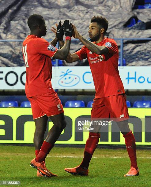 Jerome Sinclair of Liverpool celebrates his goal with team mate Sheyi Ojo during the Liverpool v Manchester United U21 Premier League game at Prenton...