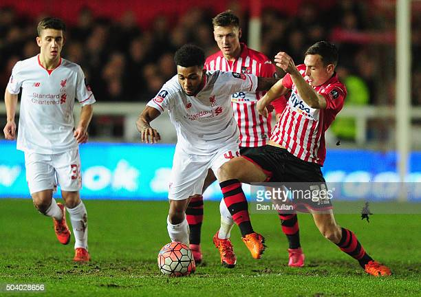 Jerome Sinclair of Liverpool holds off Jordan Tillson of Exeter City during the Emirates FA Cup third round match between Exeter City and Liverpool...