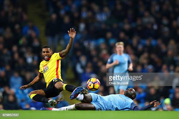 Jerome Sinclair of Watford is tackled by Yaya Toure of Manchester City during the Premier League match between Manchester City and Watford at Etihad...