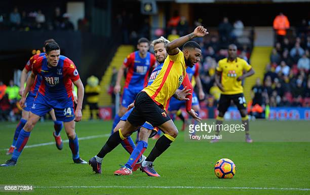 Jerome Sinclair of Watford is tackled by Yohan Cabaye of Crystal Palace during the Barclays Premier League match between Watford and Crystal Palace...