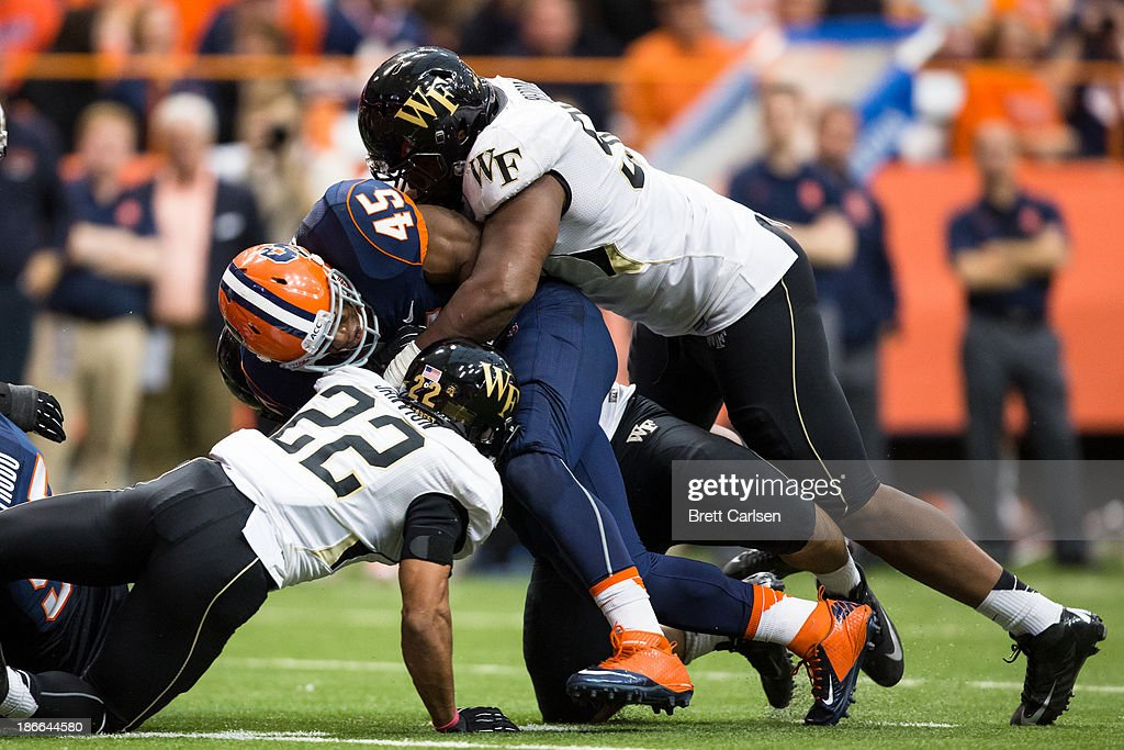 Jerome Smith #45 of Syracuse Orange is stopped by Nikita Whitlock #50 of Wake Forest Demon Deacons just short of the goal line in the fourth quarter on November 2, 2013 at the Carrier Dome in Syracuse, New York. Syracuse shuts out Wake Forest 13-0