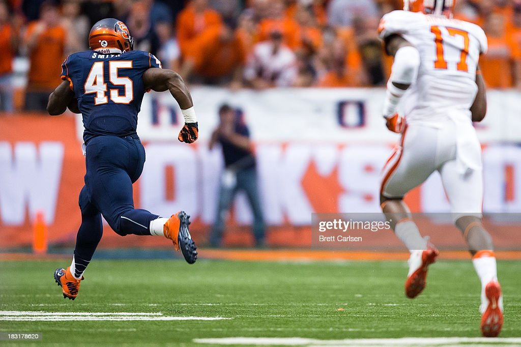 Jerome Smith #45 of Syracuse Orange runs past Bashaud Breeland #17 of Clemson Tigers among others for a touchdown to make score 21-7 Clemson Tigers leading on October 5, 2013 at the Carrier Dome in Syracuse, New York.