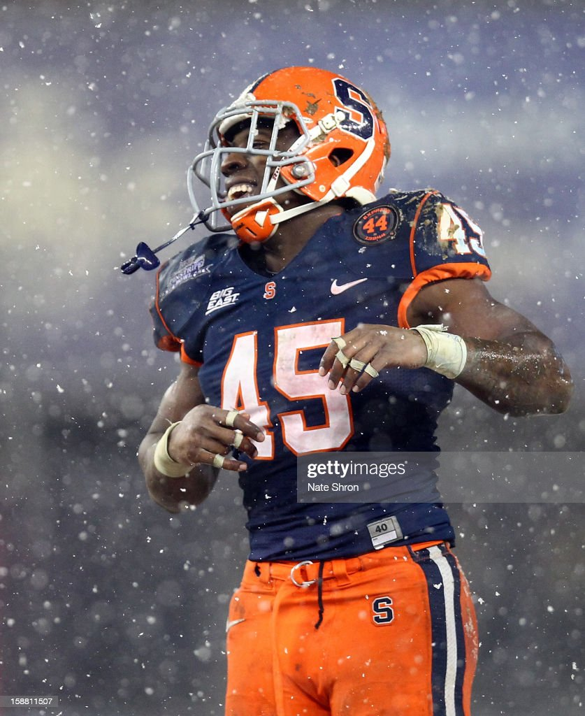 Jerome Smith #45 of the Syracuse Orange celebrates on the field during the game against the West Virginia Mountaineers during the New Era Pinstripe Bowl at Yankee Stadium on December 29, 2012 in the Bronx borough of New York City.