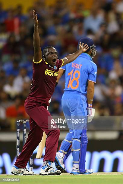 Jerome Taylor of the West Indies appeals unsuccessfully for the wicket of Virat Kohli of India during the 2015 ICC Cricket World Cup match between...