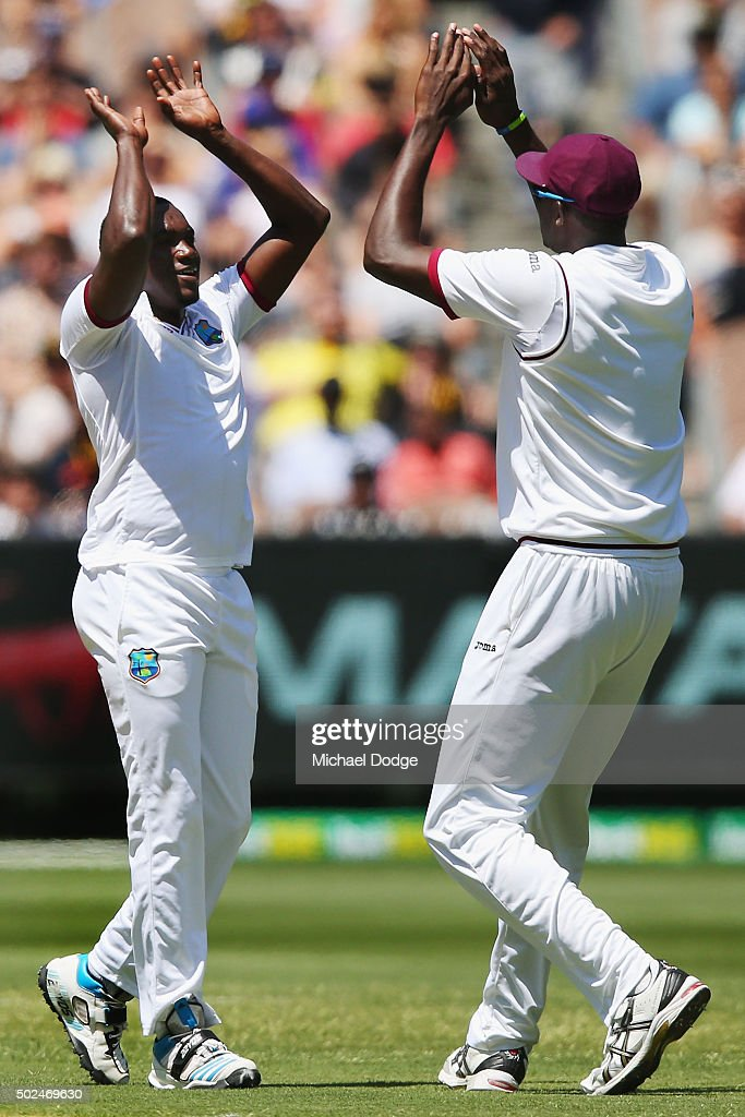 <a gi-track='captionPersonalityLinkClicked' href=/galleries/search?phrase=Jerome+Taylor&family=editorial&specificpeople=540566 ng-click='$event.stopPropagation()'>Jerome Taylor</a> of the West Indies celebrates his wicket of David Warner of Australia with <a gi-track='captionPersonalityLinkClicked' href=/galleries/search?phrase=Jason+Holder&family=editorial&specificpeople=6681136 ng-click='$event.stopPropagation()'>Jason Holder</a> (R) during day one of the Second Test match between Australia and the West Indies at Melbourne Cricket Ground on December 26, 2015 in Melbourne, Australia.