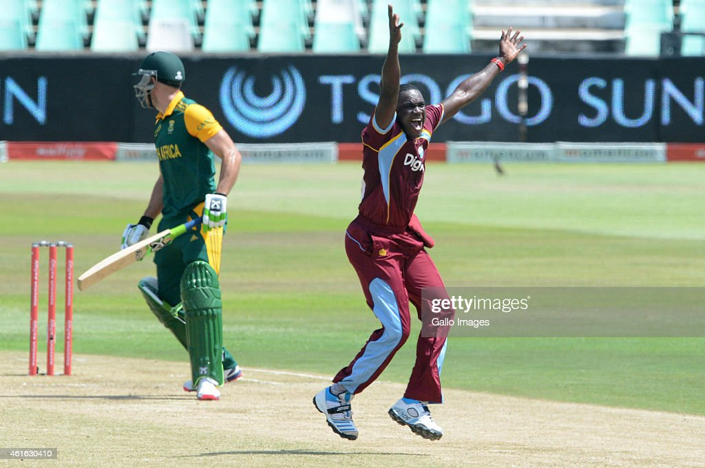 Jerome Taylor of the West Indies celebrates the wicket of Faf du Plessis of South Africa during the 1st Momentum ODI between South Africa and West Indies at Sahara Stadium Kingsmead on January 16, 2015 in Durban, South Africa.