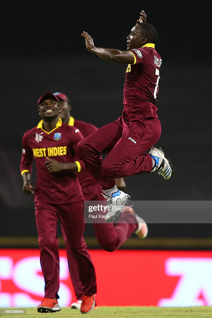 Jerome Taylor of the West Indies celebrates the wicket of Rohit Sharma of India during the 2015 ICC Cricket World Cup match between India and the West Indies at WACA on March 6, 2015 in Perth, Australia.