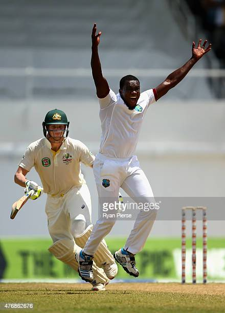 Jerome Taylor of West Indies celebrates after taking the wicket of Steve Smith of Australia LBW for 199 runs during day two of the Second Test match...