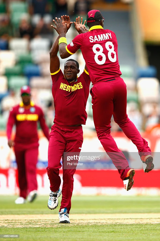 Jerome Taylor of West Indies (L) is congratulated by Darren Sammy for his wicket of Khurram Khan of the United Arab Emirates during the 2015 ICC Cricket World Cup match between the West Indies and United Arab Emirates at McLean Park on March 15, 2015 in Napier, New Zealand.