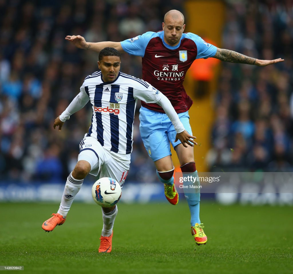 Jerome Thomas of West Bromwich Albion holds off a challenge from <a gi-track='captionPersonalityLinkClicked' href=/galleries/search?phrase=Alan+Hutton&family=editorial&specificpeople=839355 ng-click='$event.stopPropagation()'>Alan Hutton</a> of Aston Villa during the Barclays Premier League match between West Bromwich Albion and Aston Villa at The Hawthorns on April 28, 2012 in West Bromwich, England.