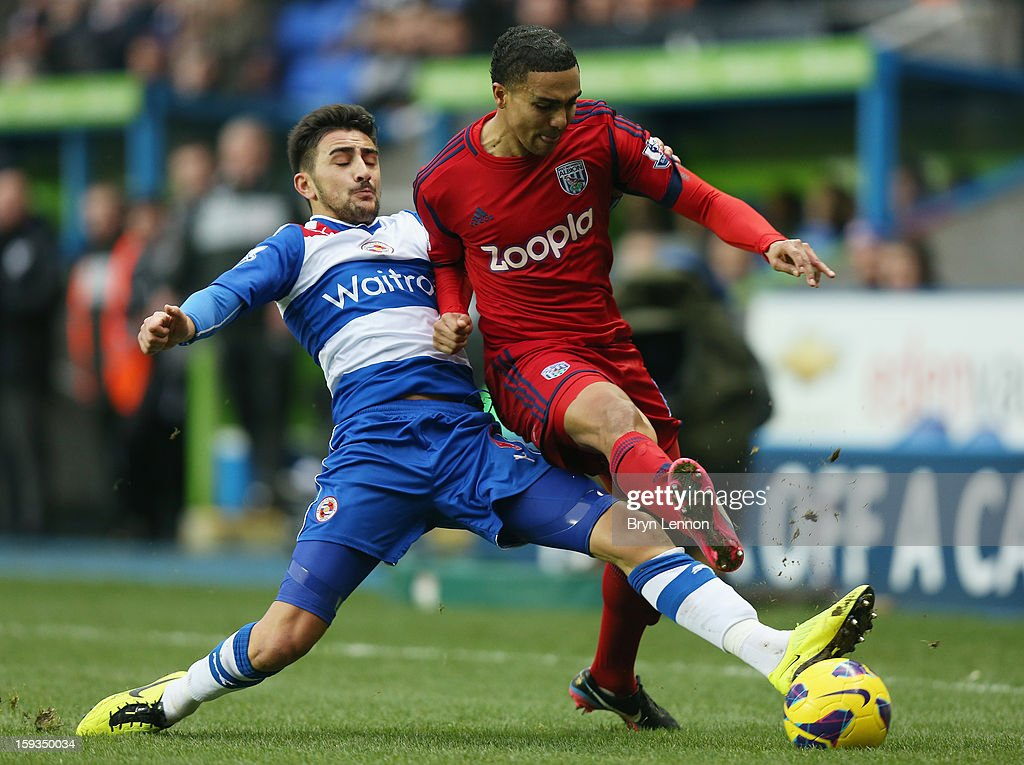 Jerome Thomas of West Bromwich Albion is tackled by Jem Karacan of Reading during the Barclays Premier League match between Reading and West Bromwich Albion at the Madejski Stadium on January 12, 2013 in Reading, England.
