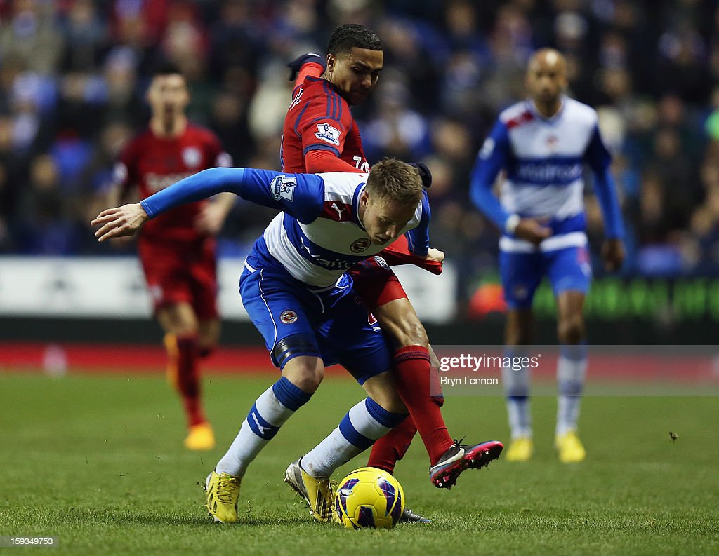 Jerome Thomas of West Bromwich Albion tackles Chris Gunter of Reading during the Barclays Premier League match between Reading and West Bromwich Albion at the Madejski Stadium on January 12, 2013 in Reading, England.