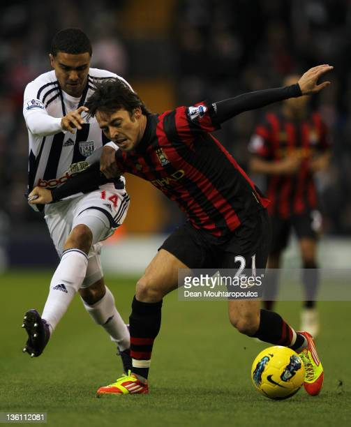 Jerome Thomas of West Bromwich and David Silva of Manchester City battler for the ball during the Barclays Premier League match between West Bromwich...