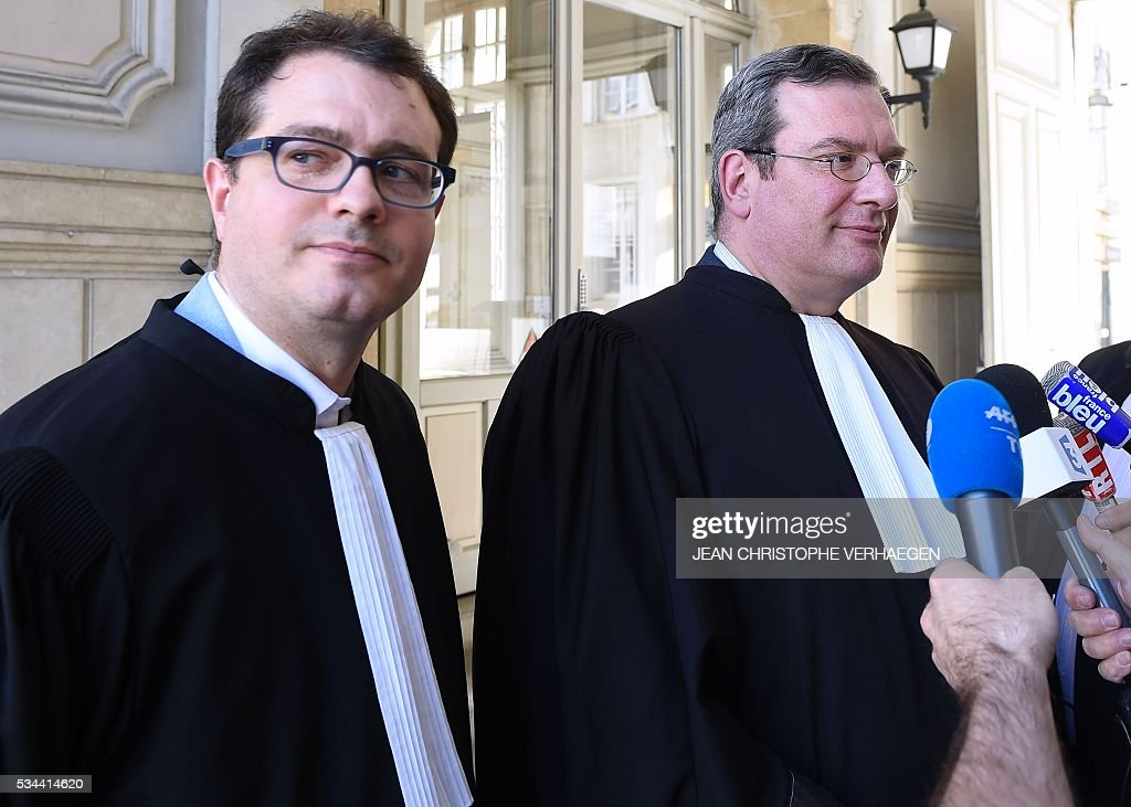 Jerome Triomphe (L) and Jean Paillot (R), lawyers of the parents of Vincent Lambert, a 38-year-old quadriplegic who is being kept artificially alive, speak to journalists after the appeal trial at the administrative court of Nancy on May 26, 2016. The administrative court examines on May 26, 2016 the request of the nephew Francois Lambert to end artificial life support for his uncle Vincent Lambert who is at the CHU of Reims. Lambert suffers from irreversible brain damage and is in a chronic vegetative state since a road accident in 2008. While his wife, nephew and doctors approve a 'passive' form of euthanasia and the withdrawal of artificial life support, Lambert's parents have refused to accept it and have fought several legal battles to keep their son on life support. / AFP / Jean Christophe VERHAEGEN