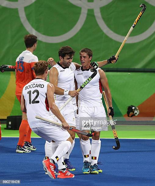 Jerome Truyens of Belgium celebrates with team mates after scoring the first goal during the Men's semi final hockey match between Belgium and the...