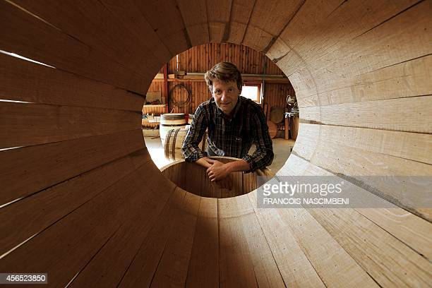 Jerome Viard a cooper in the Champagne region in eastern France poses on September 16 2014 behind a wooden barrel in the only cooperage of Champagne...